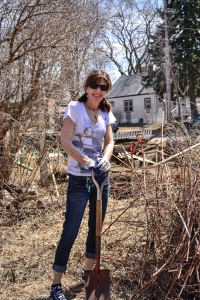 Volunteer and avid gardener Cynthia Hagen after pulling out 3 layers of bricks in the soil.