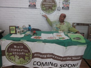 Candy, the advocate for a local grocery store in north Minneapolis, proudly displays Wirth Cooperative Grocery.