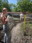 Kara and Martin duel with the donated plastic trellis - it worked great!